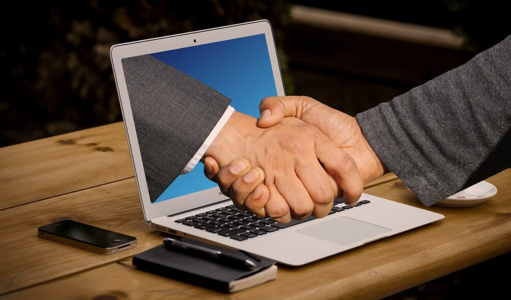 handshake, hands, laptop